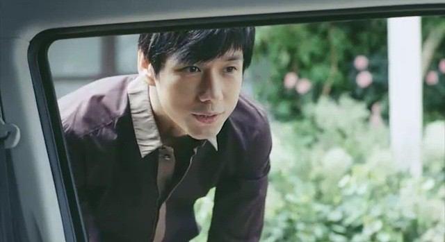 窓越しの西島秀俊さん