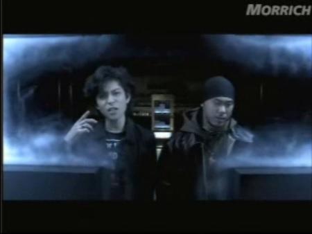 あるMV(ミュージックビデオ)の画像を貼って歌手と曲名が分かったらプラスを押すトピ
