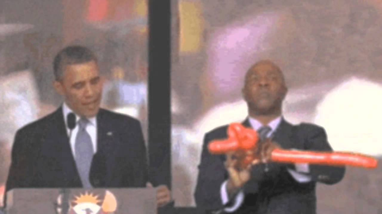 Fake interpreter at Mandela memorial makes ballon dog. - YouTube