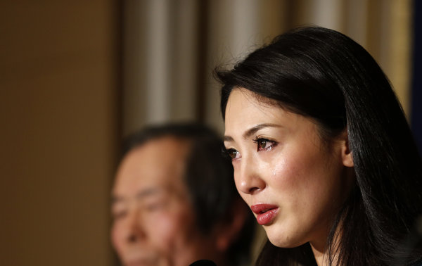 Miss International 2012 Ikumi Yoshimatsu cries during a press conference at the Foreign Correspondents' Club of Japan in Tokyo Monday, Dec. 16, 2013. Yoshimatsu, a Japanese beauty queen won't be handing over her crown to her successor after she re