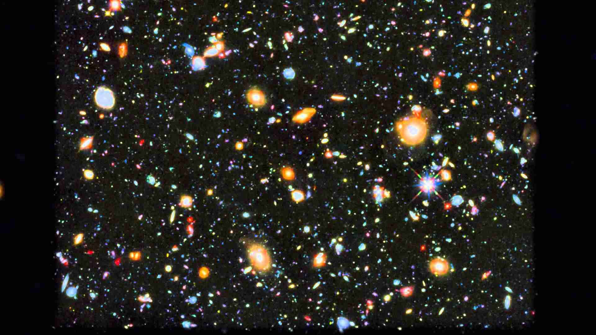 Zoom and pan of Hubble's colourful view of the Universe - YouTube