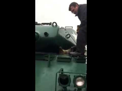 Raccoon Stuck in an Army Tank - YouTube