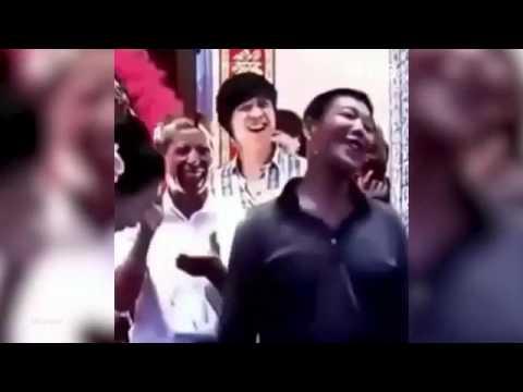Chinese man snogs son's bride during wedding to win £1,100 bet with guest - YouTube