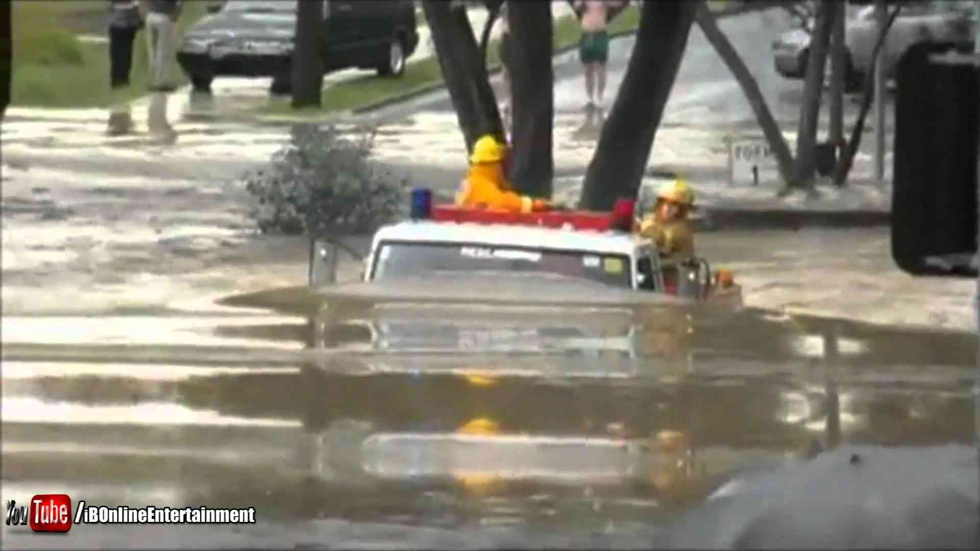 Fire truck drives through 11ft flood - YouTube