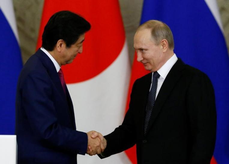 緊張緩和へ日本とロシアが緊密協力、挑発回避呼び掛け| Reuters