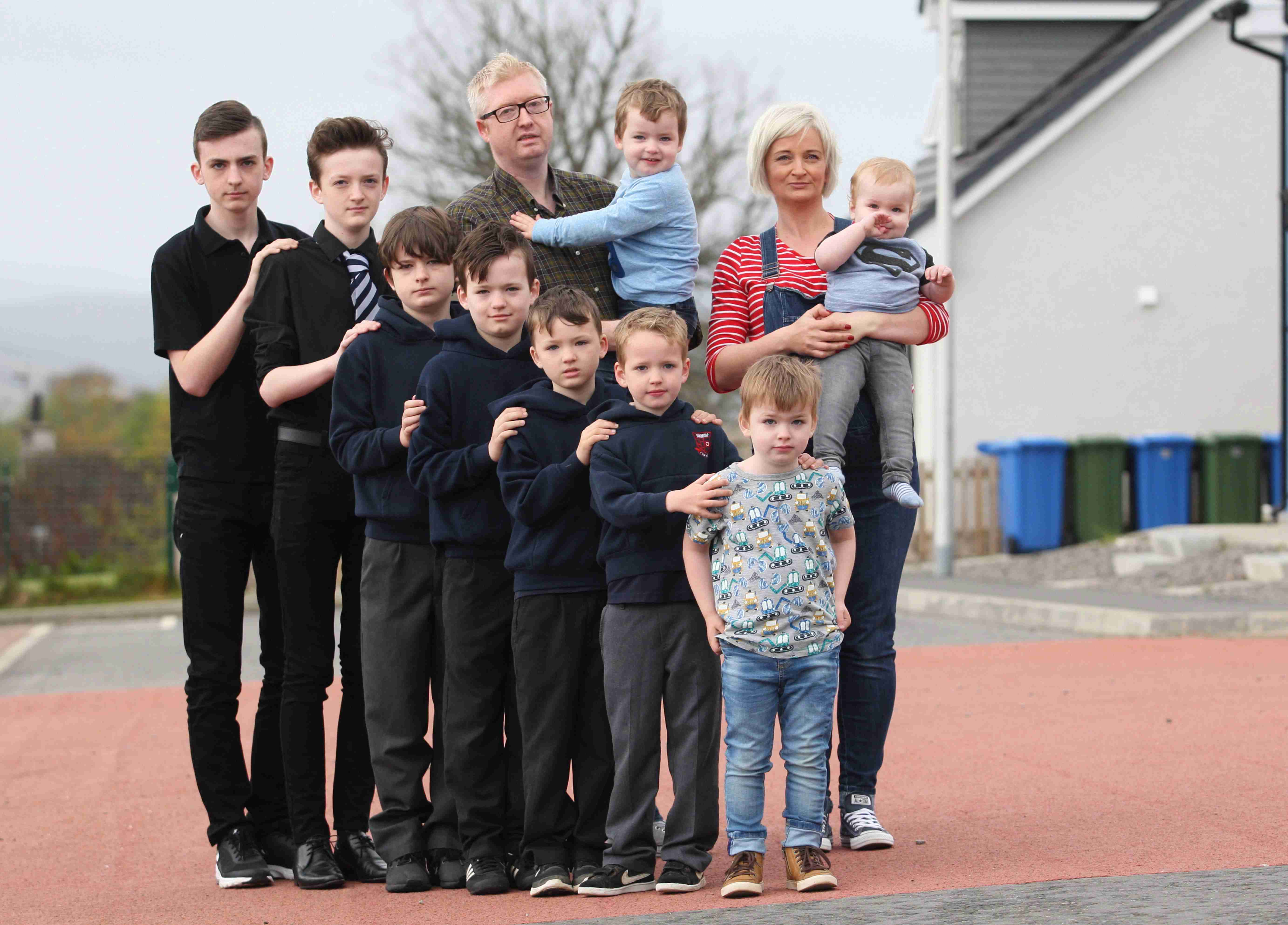 Mum of nine boys is pregnant again with her TENTH son - and she reveals they go through 84 pints of milk every week