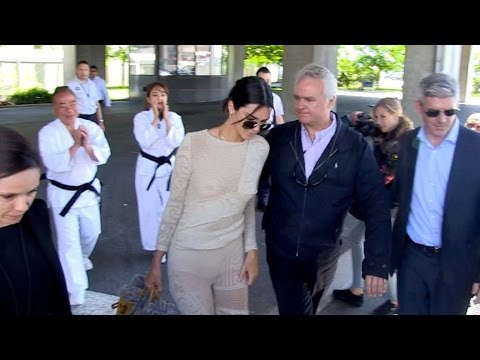 EXCLUSIVE : Braless Kendall Jenner posing with funny Japanese as she arrives in Cannes - YouTube