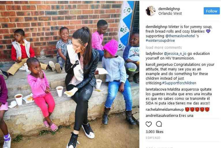ミス南アフリカ HIV感染の黒人孤児に手袋をはめ食事を提供、批判の的に