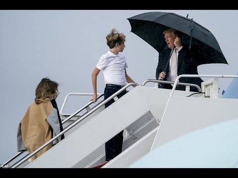 What a gent! Donald Trump makes sure umbrella protects his famous locks - YouTube