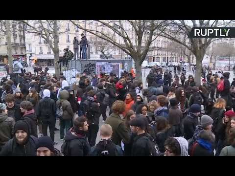 Clashes break out in Paris during rally against Macron's public sector reforms - YouTube