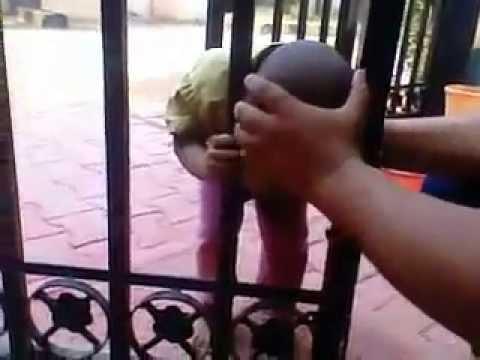 Funny Hyderabadi kid head stuck in gate - YouTube