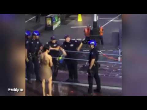 Naked man Donald Trump protester 'Krit McClean' doing chicken dance in New York's Times Square - YouTube