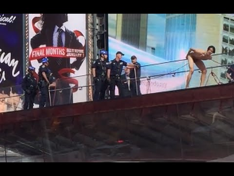Naked Donald Trump protester, model Krit McClean Times Square New York jumps from TKTS booth - YouTube