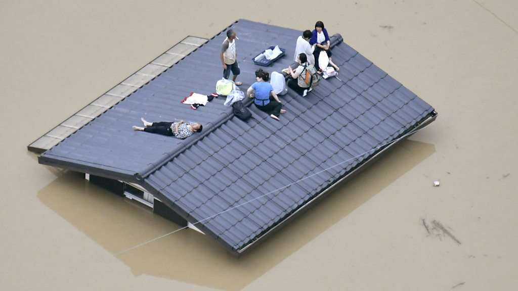 Japan floods: 'Extreme danger' amid record rainfall - BBC News