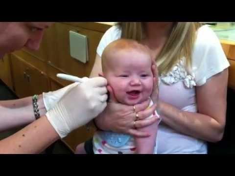 Baby's pierced ears. - YouTube